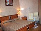 """Курортный отель """"Сосновая роща"""", корпус №1, спальня номера Delux II"""